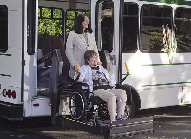woman in a wheelchair using a chair lift
