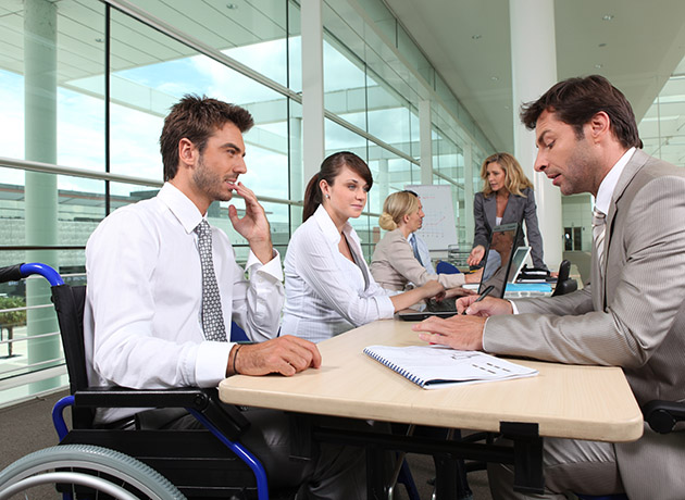 Businessman in wheelchair at office