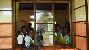 Photo of school children looking out window