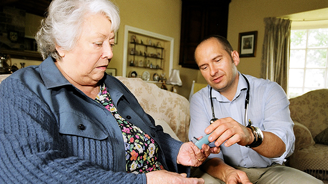 Physician helping woman with medication