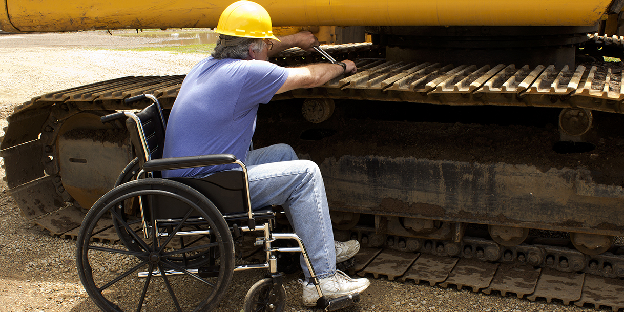 worker wearing hard hat in wheelchair
